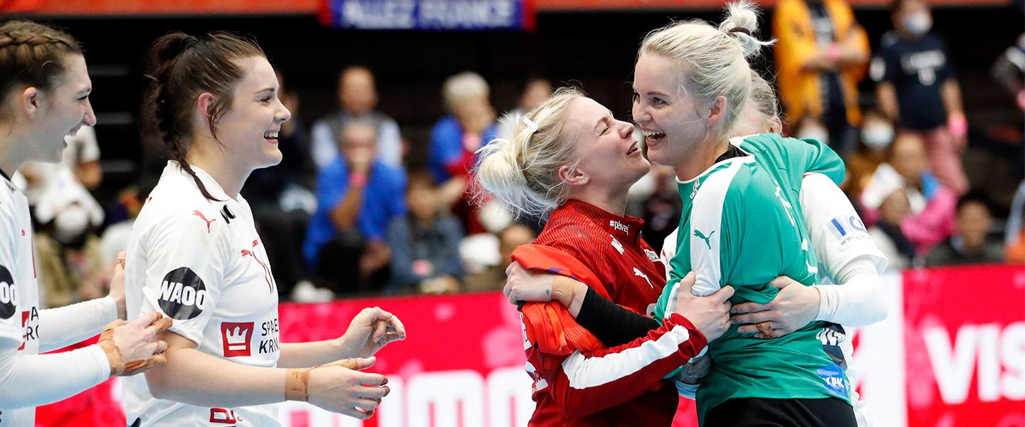 Denmark win do-or-die match and advance to main round